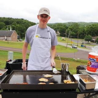 Will Coyne, of Operation Breakfast, serving meals to disaster survivors in West Plains.