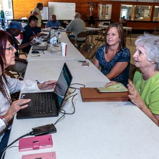 Flood survivors register for assistance at a Disaster Recovery Center in Van Buren