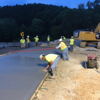 Workers pour a new lane on Route T in Wayne County