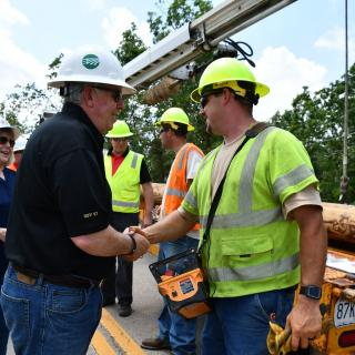 Governor Mike Parson meets with utility workers restoring services following the tornado in Jefferson City.